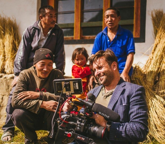 Showing the locals in Bhutan what I had just filmed of them.