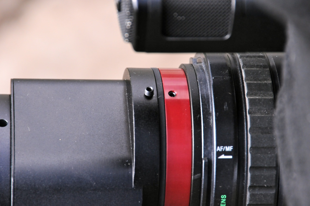 The grub screw on left are used to adjust X/Y to centre the image