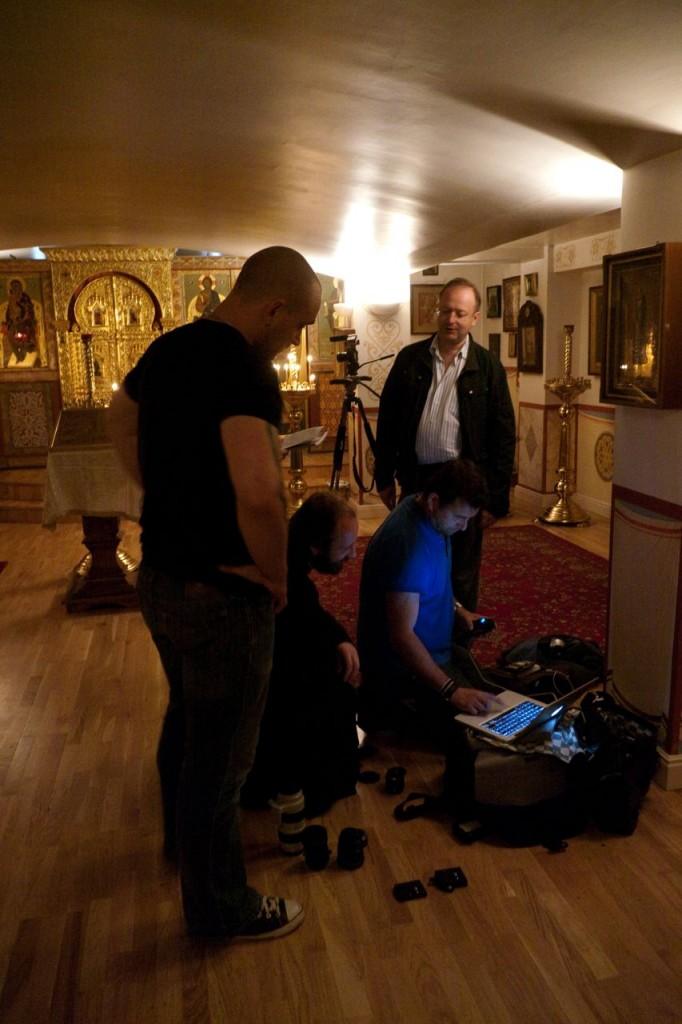 Alan, Producer Alexander Korboko and Father Nikolai looking back at a take